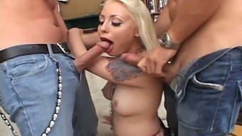 A blonde in fishnets deepthroats after that gets twice penetrated
