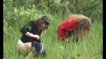 Two different white amateur ladies in the woods pissing jointly