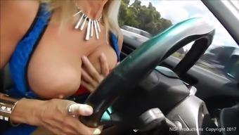 Slut broken large tits while driving