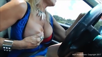 Slut broken large tits while driving