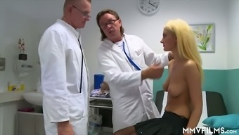 Horn-mad blonde girl in stockings Gabriella Daniels gives the health professional with the use of BJ