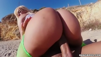 bootylicious blondie fesser cycling a big cock on a seaside