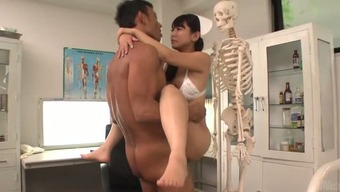 Skanky clinician Yu Shinohara is fucking her boss in his business office