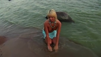Well designed blond gets bare on the beach with in erotic riff send