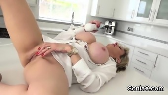 Adulterous the english language milf female sonia displays her giant boobs