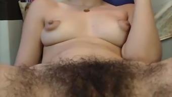 Fuzzy girl, swollen nips brushing pussy