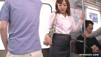 Slutty Japanese hen Mami Asakura is fucked by a variety of people they don't know inside the subway car