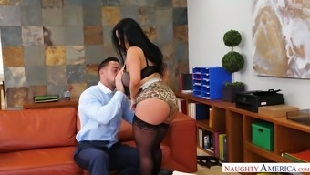 Big breasted suntanned desk staff Sheridan Completely love gives a really top notch BJ