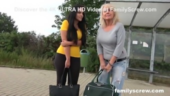 Dads picking up mother and daughter