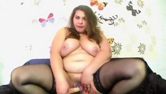 Chubby brunette masturbating with a big dildo
