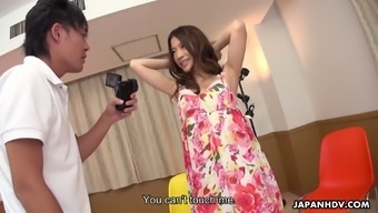 Kinky slender Japanese model Saya Aika gets poked doggy style by photographer