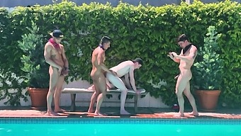 Four horny gay guys take turns at pleasing each other by the pool