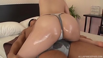 Horny Japanese girl Azumi Chino loves massaging a friend's cock