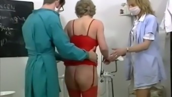 Blond mature lady likes to have evil threesome within the gyno's business office