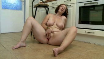 Numerous brunette youngster belongings her brushed puffy slit with the use of two fingers
