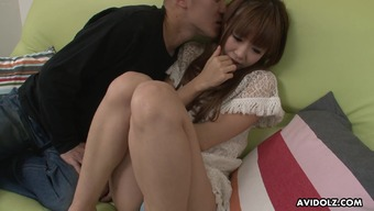 Fairly Japanese pornstar acts back with her furry pussy