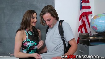 Brunette instructor Kendra Want instructing Lucas a tutorial