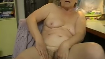 Attractive light colored haired granny masturbates with the use of dildo in bedroom
