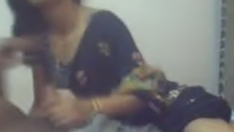 Lively Indian female exposes her titties on camera