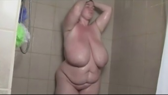 Excess weight brunette Takes a bathe