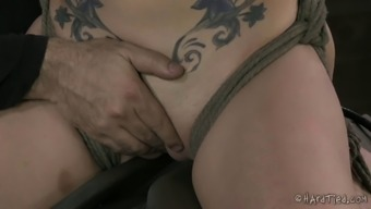 Inked tool in bondage satisfied by using first-rate smack