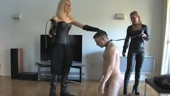 Two different blond mistresses whipping guys person who serves 02