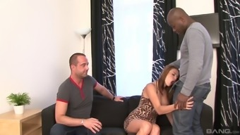 Cuckold associated with a man timepiece his damsel savoring the massive chocolate penis