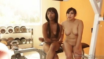 Spunky lesbians Annie Cruz and her ebony friend are giving an interview