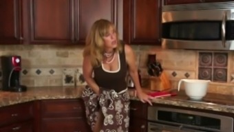 Stepmother Jodi Western fucks youngster in the kitchen after moving him on!
